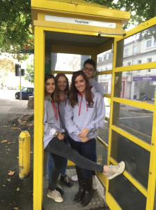 law students in phone box